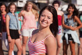 Upbeat Teenage Girl Smiling — Stock Photo