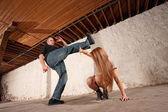 Man Kicks Young Woman — Stock Photo