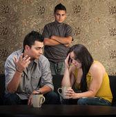 Verontruste ouders met boos zoon — Stockfoto