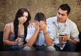Triest mannelijke tiener met ouders — Stockfoto