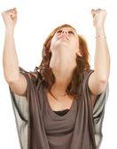 Vrouw met vuisten in de lucht — Stockfoto