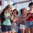 Young Ladies Using Their Phones — Stock Photo