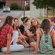 Female Students Sitting on the Ground — Stock Photo #13313638