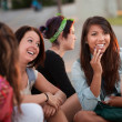 Fascinated Asian Teen with Friends — Stock Photo