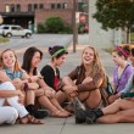Eight Pretty Girls Sitting Outdoors — Stock Photo