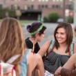Young Woman Laughing with Friends — Stock Photo