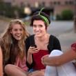 Foto Stock: Excited Female Teens Looking at Phone
