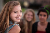 Smiling Teen Girl with Two Friends — Stock Photo