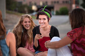 Excited Female Teens Looking at Phone — Stock Photo