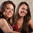 Stock Photo: Two Beautiful Women Sitting Together