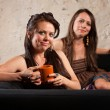 Satisfied Coffee Drinkers on Sofa — Stock Photo