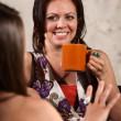 Smiling Woman Drinking Coffee with Friend — Stock Photo