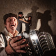 Stock Photo: Accordion Player Singing For Dancers