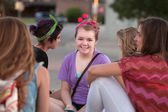 Cute Teen in Purple with Friends — Stock Photo
