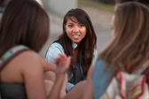 Cute Asian Student with Friends Outside — Stock Photo