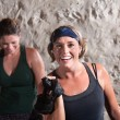 Stock Photo: Smiling Women Working Out