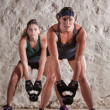Beautiful Women in Boot Camp Style Workout — Stock Photo