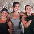 Foto Stock: Three Sweaty Boot Camp Workout Women