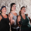Foto Stock: Three Boot Camp Style Workout Ladies Flex Their Biceps