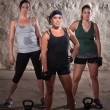 Foto Stock: Standing Women Doing Boot Camp Style Workout