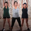 Ladies Lifting Weights in Boot Camp Workout - Stock Photo