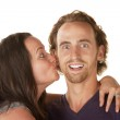 Lady Kisses Excited Man — Stock Photo #14935147