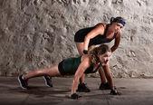 Boot camp trainer met vrouw — Stockfoto