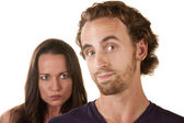 Sneaky Man with Skeptical Girlfriend — Stockfoto