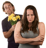Angry Woman and Man with Flowers — Stock Photo