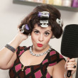 Woman in Curlers Holding Mirror - Stock Photo