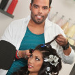 Foto Stock: Stylist Removes Hair Curlers