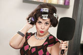 Woman in Curlers Holding Mirror — Stock Photo