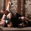 Martial Artist Punching Mon Ground — Stockfoto #16352705