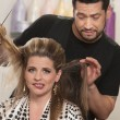 Stock Photo: Embarrassed Womwith Hairdresser