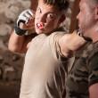 Stock Photo: Fighter Throws Punches