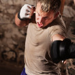 Stock Photo: Mixed Martial Artists Sparring