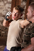 Fighter Throws Punches — Stock Photo