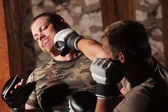 Male Fighter Hit in Jaw — Stock Photo