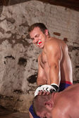 Man Strikes Opponent with Knee — Stock Photo