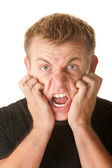 Angry Man Clawing His Face — Stockfoto