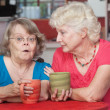 Concerned Friends Talking in Cafe — Stock Photo