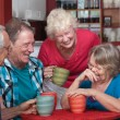 Laughing Friends in Coffeehouse — Stock Photo #17646993
