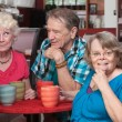 Foto Stock: Happy Group of Seniors in Bistro