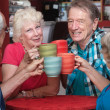 Senior Adults Toasting with Mugs — Stock Photo