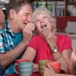 Laughing Elderly Couple with Friends — Stok fotoğraf