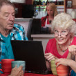 Elderly Woman with Friends and Laptop — Stock Photo