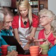 Woman Helping Seniors with Computer — Stock Photo
