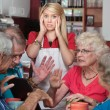 Bickering Seniors and Young Waitress — Stock Photo