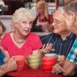 Pretty Senior Woman Talking with Friends — Stock Photo