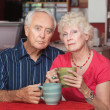 Serious Senior Couple with Coffee — ストック写真